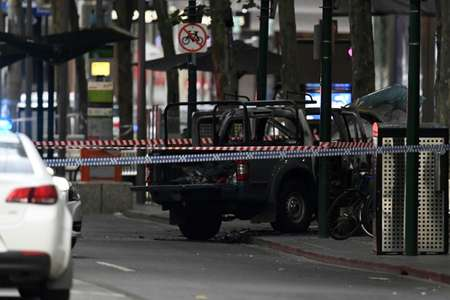 Witnesses said the man set fire to his vehicle before going on his knife rampage ( WILLIAM WEST (AFP) )
