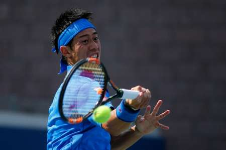 Kei Nishikori downed German Benjamin Becker 6-1, 6-1, 3-6, 6-3 to advance at the US Open ( Kena Betancur (AFP) )