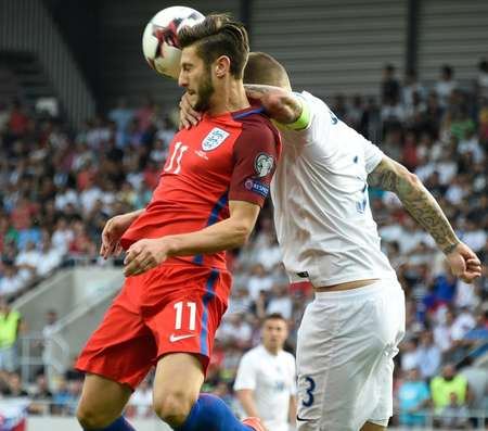 Adam Lallana (left) and Slovakia's Martin Skrtel compete for the ball during the World Cup qualifier in Trnava on September 4, 2016 ( Joe Klamar (AFP) )