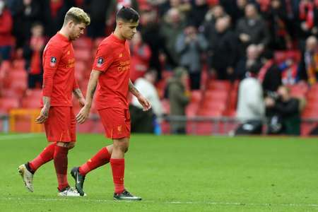 Liverpool's Alberto Moreno (L) and Philippe Coutinho leave the pitch following their English FA Cup loss to the Wolverhampton Wanderers at Anfield in Liverpool, north west England on January 28, 2017 ( Paul ELLIS (AFP) )