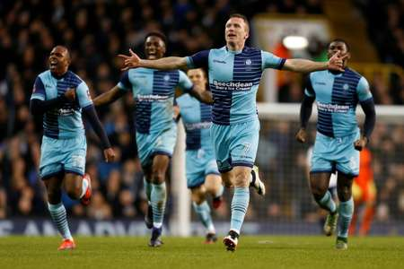 Wycombe Wanderers' Garry Thompson (2R) celebrates scoring his team's third goal against Tottenham Hotspur at White Hart Lane in London, on January 28, 2017 ( Ian KINGTON (AFP) )