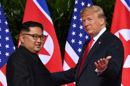 US President Donald Trump and North Korea's leader Kim Jong Un, at the start of their historic summit in in Singapore on June 12, 2018 ( SAUL LOEB (AFP/File) )