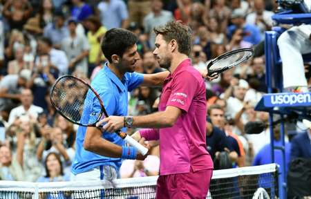 Stan Wawrinka of Switzerland embraces Novak Djokovic of Serbia after their 2016 US Open final match, at the USTA Billie Jean King National Tennis Center in New York, on September 11, 2016 ( Jewel Samad (AFP) )