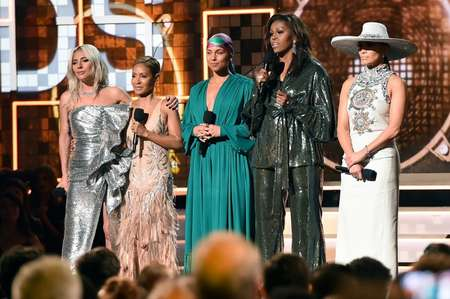 (L-R) US singer-songwriter Lady Gaga, Jada Pinkett Smith, Host US singer-songwriter Alicia Keys, former US First Lady Michelle Obama and US singer Jennifer Lopez speak on stage during the 61st Annual Grammy Awards on February 10, 2019, in Los Angeles.  ( Robyn BECK                          (AFP) )
