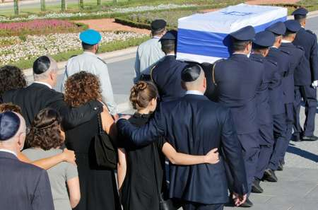 Family members walk behind the coffin of former Israeli premier Shimon Peres at the start of his funeral in Jerusalem ( Gil Cohen-Magen (AFP) )