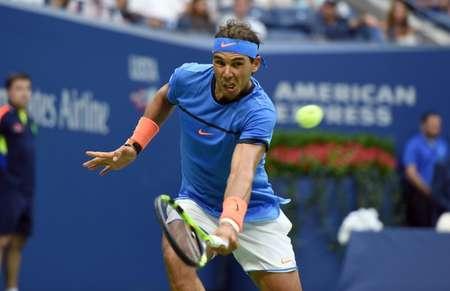 Rafael Nadal of Spain hits a return against Lucas Pouille of France on September 4, 2016 ( Don Emmert (AFP) )