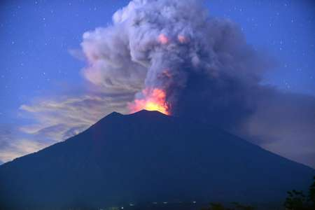 Mount Agung is throwing out smoke, hot gases and fragments of molten rock as an eruption looms  ( SONNY TUMBELAKA (AFP) )