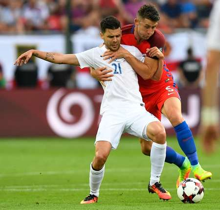England's Gary Cahill (right) challenges Slovakia's Michal Duris during the World Cup qualifier ( JOE KLAMAR (AFP) )