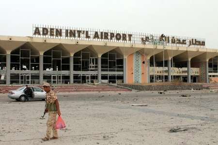 Armed militiamen loyal to Yemen's fugitive President Abderabbo Mansour Hadi stand at the entrance to Aden's international airport on July 14, 2015, which they recaptured from Shiite Huthi rebels ( Saleh al-Obeidi (AFP) )