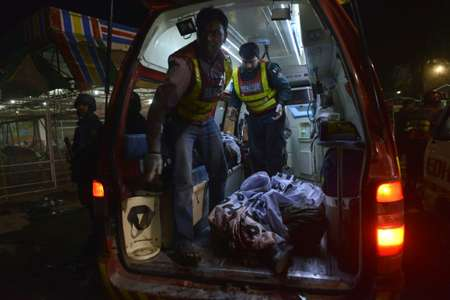 Pakistani rescuers carry a body in an ambulance from a bomb blast site in Lahore on March 27, 2016 ( Arif Ali (AFP) )
