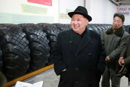North Korean leader Kim Jong-Un visits the Amnokgang Tyre Factory, where tyres for the missile launcher used in the latest test were reportedly made ( - (KCNA VIA KNS/AFP) )