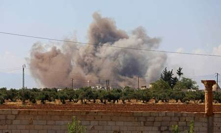 Smoke billows following a bombardment by Syrian government forces around the town of Khan Sheikhun on the southern edges of the rebel-held Idlib province on September 8, 2018  ( OMAR HAJ KADOUR (AFP) )