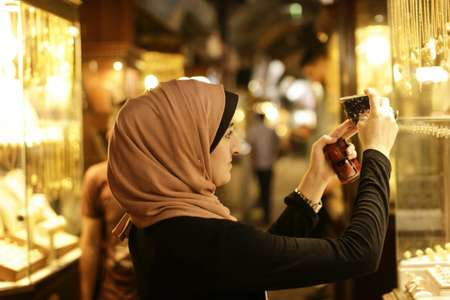 Palestinian Kholoud Nassar, 26, takes pictures in her native Gaza City, shuttered from most of the world by a decade-long Israeli blockade ( MAHMUD HAMS (AFP) )