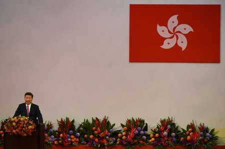 China's President Xi Jinping gives a speech following the swearing-in of Hong Kong's new Chief Executive Carrie Lam as the territory's new leader during a ceremony at the Convention and Exhibition Centre in Hong Kong