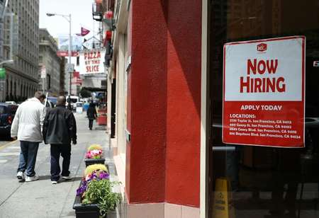 A 'now hiring' sign is posted in the window of a fast food restaurant on July 8, 2016 in San Francisco, California ( Justin Sullivan (Getty/AFP) )