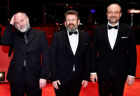 (L to R) Vlad Ivanov, Adrian Titieni and Cezar Paul Badescu pose on the red carpet for the premiere of the film