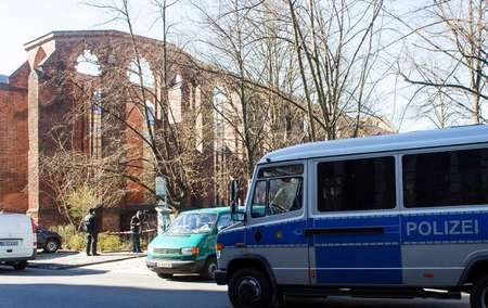 Police cars stand in front of the ruins of the Franciscan Monastery in Berlin on April 5, 2015, where the body of an Israeli man was found ( Maurizio Gambarini (DPA/AFP/File) )