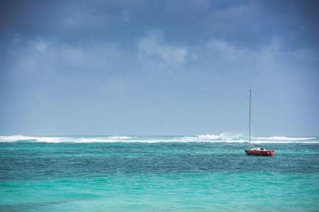 A small boat is seen as the swell increases, ahead of the arrival of Hurricane Irma ( Lionel CHAMOISEAU (AFP) )