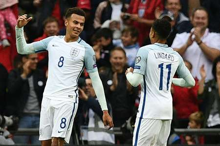 Dele Alli (left) celebrates with Jesse Lingard after scoring their England's second goal against Malta ( Justin Tallis (AFP) )