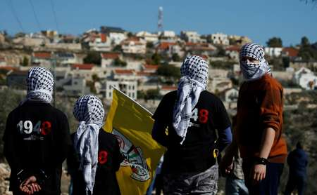 Palestinian protestors stand facing the Israeli settlement of Qadumim (Kedumim) during clashes with Israeli security forces  ( JAAFAR ASHTIYEH (AFP/File) )