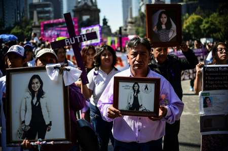 Relatives and friends of women killed in Mexico marched along the Reforma boulevard in the capital to demand action and honours the memory of victims ( RONALDO SCHEMIDT (AFP) )