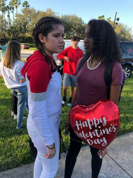 Students outside Marjory Stoneman Douglas High School in Parkland, Florida, following a shooting at the school ( Michele Eve SANDBERG (AFP) )
