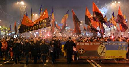 Thousands of Ukrainian nationalists hold a torchlight procession across Kiev on January 1, 2015 in honour of Stepan Bandera, a World War II anti-Soviet insurgent ( Genya Savilov (AFP) )
