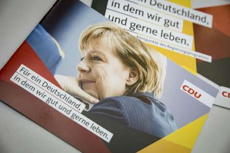 A portrait of German Chancellor and leader of the Christian Democratic Union party (CDU) Angela Merkel is seen on a leaflet at the CDU's headquarters in Berlin, ahead of general elections ( AXEL SCHMIDT (AFP) )