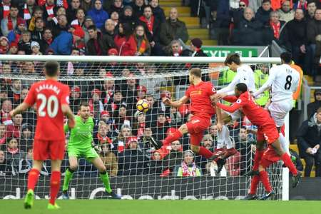 Swansea City's striker Fernando Llorente (3rdR) rises high to head the ball and score against Liverpool on January 21, 2017 ( Anthony DEVLIN (AFP) )