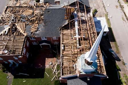 In this aerial view, a storm damaged church is seen in the aftermath of Hurricane Michael in Panama City, Florida ( Brendan Smialowski (AFP) )