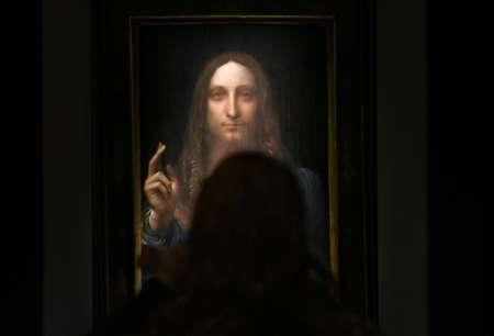Le tableau du peintre italien Léonard de Vinci adjugé 450,3 millions de dollars photographié le 3 novembre 2017 à New York ( TIMOTHY A. CLARY (AFP/Archives) )