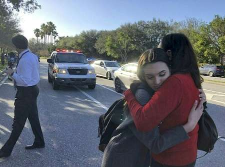 Students embrace each other after the shooting ( Michele Eve SANDBERG (AFP) )