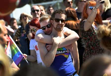 Australians have voted in favour of allowing same-sex couples to marry, sending the task of legalising marriage equality to a deeply divided parliament ( WILLIAM WEST (AFP) )