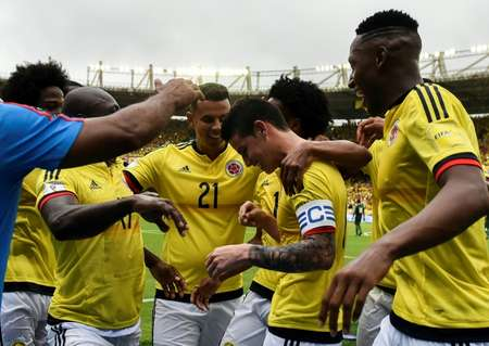 Colombia's midfielder James Rodriguez (2nd R) is congratulated by teammates after scoring a goal against Bolivia on penalty during their 2018 FIFA World Cup qualifier match, in Barranquilla, on March 23, 2017 ( Luis Robayo (AFP/File) )