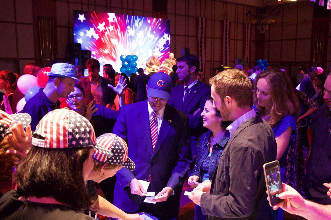 US Ambassador to Israel Dan Shapiro (C) plays some election themed games with voters at the 2016 US Embassy election party in Tel Aviv