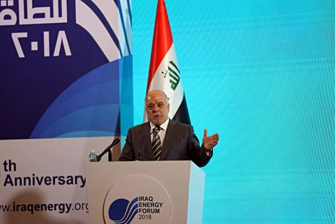 Iraq Prime Minister Haider al-Abadi gestures, during a press conference, in Iraq Energy Forum in Baghdad, Iraq, Wednesday, March 28, 2018.