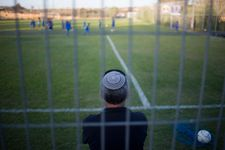 Israel allowed to air soccer matches to settlements after UEFA withdraws demand