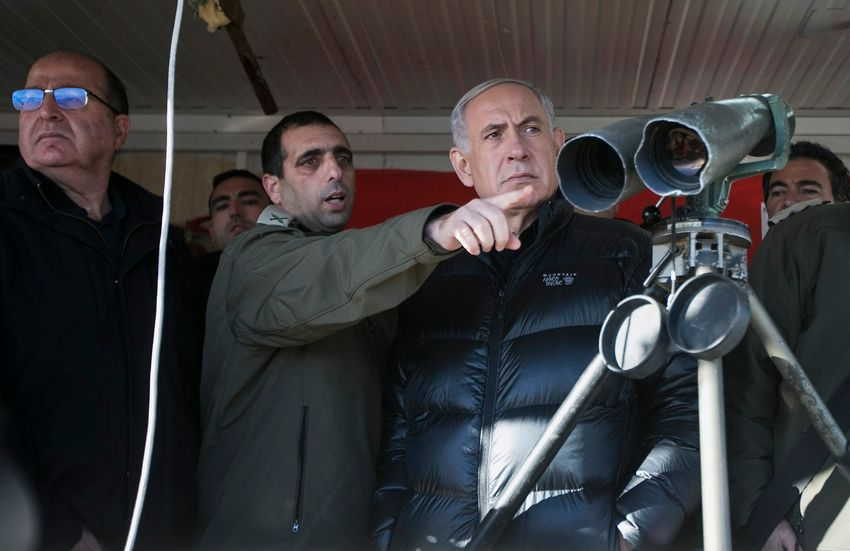 FILE: Israel's Prime Minister Benjamin Netanyahu, center, and former Defense Minister Moshe Yaalon, left, stand next to Israeli soldiers at a military outpost during a visit at Mount Hermon in the Israeli-controlled Golan Heights overlooking the Israel-Sy
