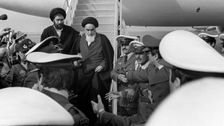 Photo taken 01 February 1979 at Tehran airport of revolutionary leader Ayatollah Ruhollah Khomeini (C) leaving the Air France Boeing 747 jumbo that flew him back from exile in France to Tehran
