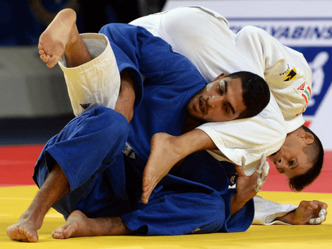 Israel's judoka Tohar Butbul (blue) competes with Miklos Ungvari from Hungary during the mens qualification match, in the -73 kg category at the the IJF Judo World Championship in Astana, on August 26, 2015