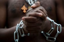 Eritrean migrants wear chains to mimic slaves at a demonstration against the Israeli government's policy to forcibly deport African asylum seekers from Israel to Uganda and Rwanda, outside the Knesset, Israel's parliament, in Jerusalem.