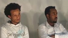 Simon (L) and Shikur, two Eritrean asylum seekers who agreed to leave Israel for Rwanda, photographed in Berlin