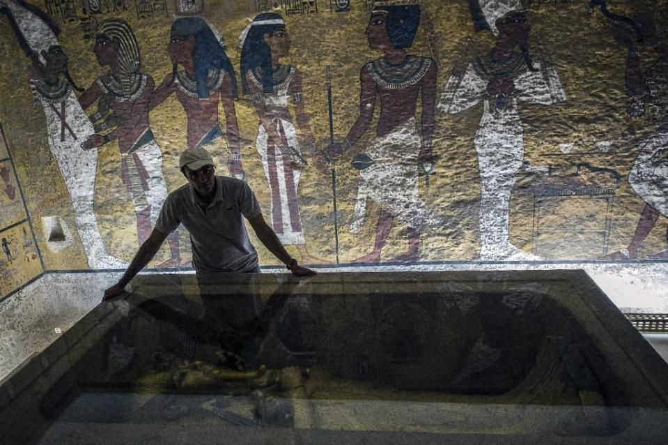 An Egyptian archaeologist looks at the sarcophagus of King Tutankhamun in his burial chamber in the Valley of the Kings, close to Luxor, on September 28, 2015