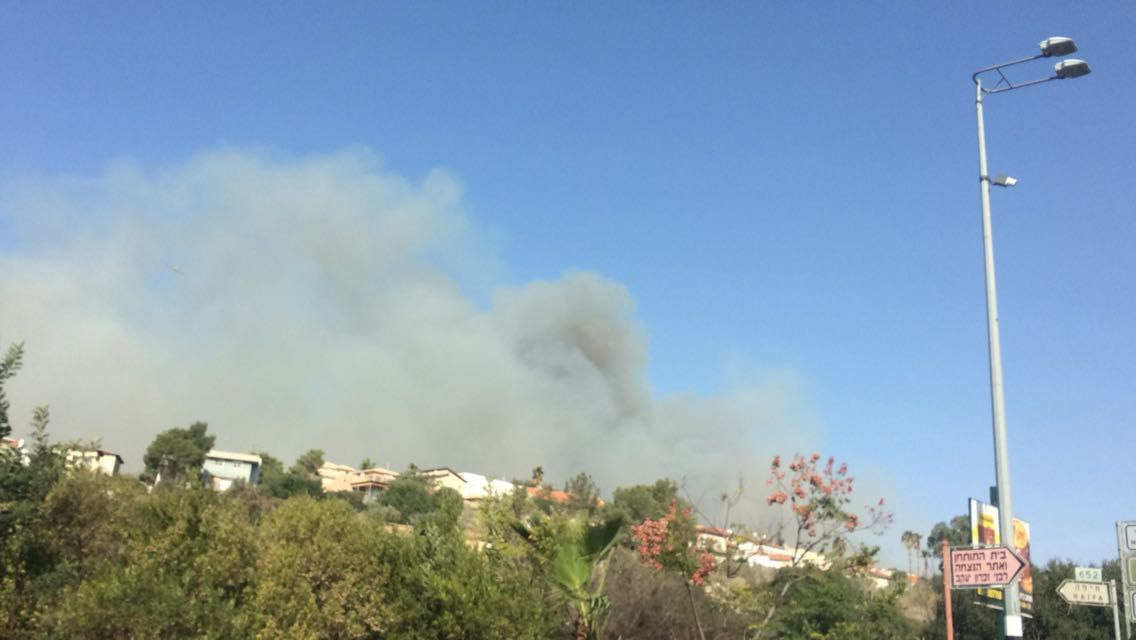 Plumes of smoke rise from a fire burning in Zichron Yaakov on November 22, 2016