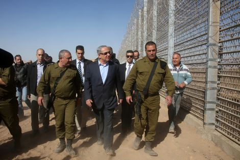 FILE: Israeli Prime Minister Benjamin Netanyahu walks with IDF Chief of Staff Gadi Eizenkott, left, as they visit the construction work on the fence between Israel and Jordan Tuesday, Feb. 9, 2016.