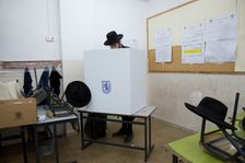 An Ultra-Orthodox Jewish man votes at a polling station during the municipal elections in Jerusalem, Tuesday, Oct. 30, 2018.