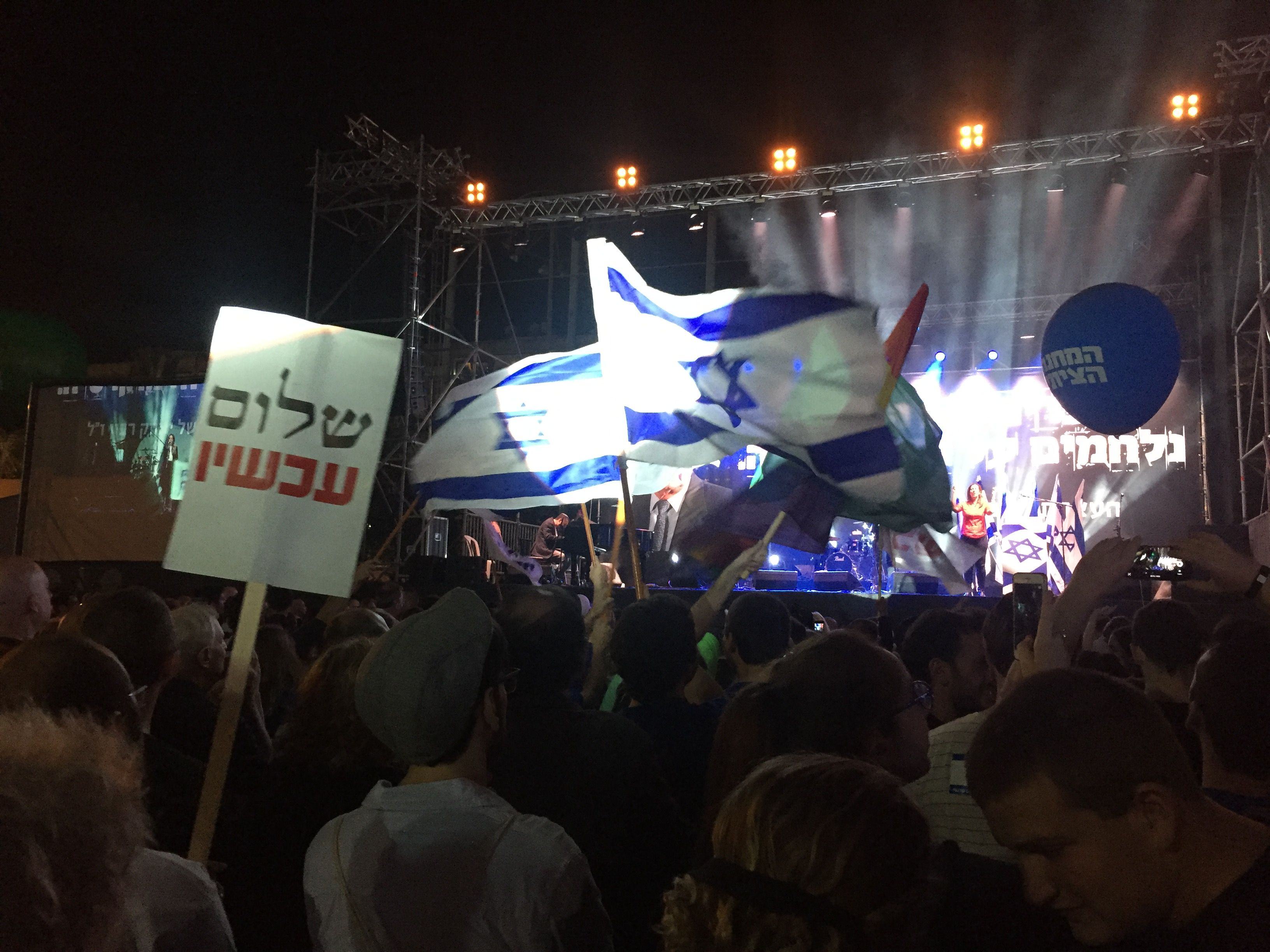 Activists from left-wing political groups Labor and Meretz along with pro-Peace group Peace Now wave flags at the Rabin memorial rally