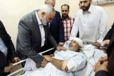In this photo released by the Hamas media office, Ismail Haniyeh, head of the Hamas political bureau, visits Gen. Tawfiq Abu Naim at Shifa Hospital in Gaza City, Friday, Oct. 27, 2017.