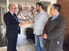 Israeli-Arab activist Raja Zaatry and Haifa University Professor Assad Ghanem present British diplomat Patrick Haughey with a letter on November 7 2017