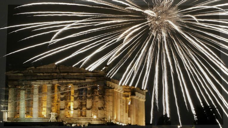 Fireworks explode above the ancient Parthenon temple atop the Acropolis hill during New Year's celebrations in Athens on January 1, 2017.